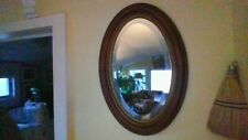 Antique oval, walnut, beveled mirror in perfect condition