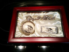 Fishermans silvertone pocket watch & money clip in a dark wood display case.