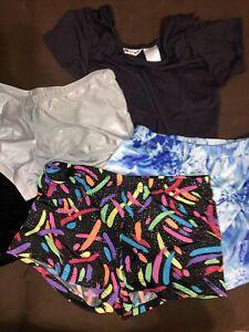 5 piece lot gymnastics/ dance shorts and 1 Plain Black Leotard Size M-L Child
