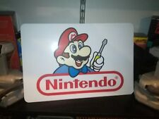 "Nintendo Repair Display, Nintendo Aluminum Sign, 12"" x 18""."