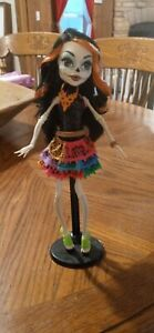 monster high skelita calaveras doll with stand.