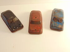 3 vintage tin toy cars with rubber or plastic wheels