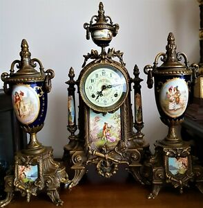 FRENCH IMPERIAL STYLE GILT AND PORCELAIN MANTEL CLOCK GARNITURE by Franz Hermle