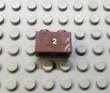 LEGO Reddish Brown 1x2 Brick with Gold 2 10194 Emerald night Sticker