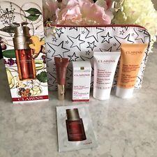 Clarins 7 Pieces Travel Gift Bag. Cleanser, Balm, Tonic, Lip Base, Eye & Serum.