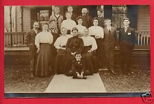 RPPC GROUP OF MEN WOMEN & BOY IN FRONT OF A HOUSE PORCH RAILING POSTS RPPC
