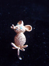 Sweet little vintage gold tone mouse brooch with green glass eyes