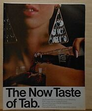 1966 magazine ad for Tab soda - woman with giant mod earrings pours a glass