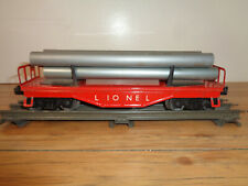 LIONEL O GAUGE # 6121 RED METAL PIPE CAR WITH GRAY PLASTIC PIPES