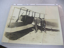 Vintage Black and White Photograph of Airplane With Pilot