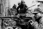WW2 photo Chinese machine gunner takes aim among city ruins #442