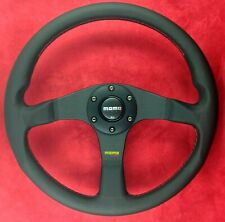 Genuine Momo Tuner black spokes leather 350mm steering wheel with red stitching.