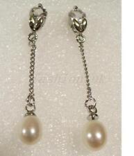 Orecchini di bigiotteria farfalline perle bianche