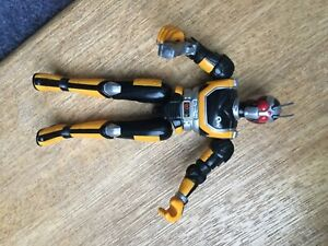 "Vintage 1995 Masked Rider 5.5"" figure from Bandai, Yellow and Black"