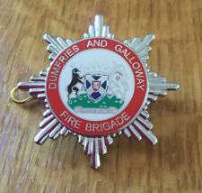 An old Dumfries and Galloway  Fire Brigade, enamel cap badge.