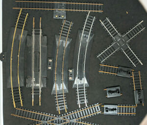 HO MARX, AHM TYCO: MIXED TRACK. Crossings Rerailers Bumpers 11 Piece Lot Vintage