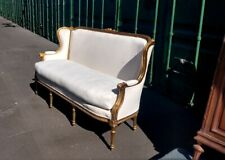 Gorgeous French Louis Xvi Gilded Wingback Sofa with Decorative Serpentine motif