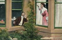 1908 VINTAGE COUPLE in LOVE on a BALCONY POSTCARD - USED