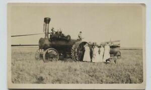 1910 era Large Steam? tractor harvesting on Prairie Real Photo Postcard RPPC