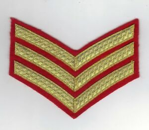 BRITISH ARMY SERGEANTS DRESS INSIGNIA/CHEVRON FOR NO 1 DRESS GOLD ON RED