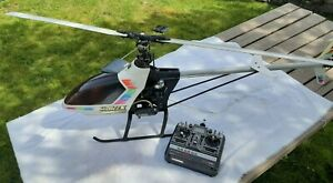 Hirobo Shuttle Zxx Helicopter with Futaba FP-T7UHP remote control, manuals inc.