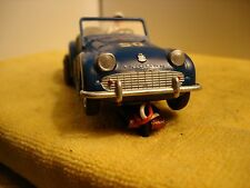 Vintage 1959 triumph TR3A 1/32 SLOT CAR offered by MTH.