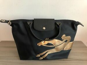 Longchamp black/gold top-handle crossbody handbag