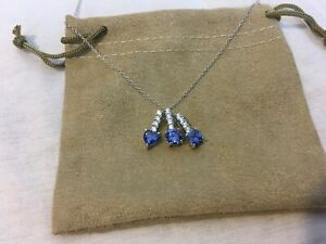 12.20CTW Tanzanite And White Diamond Simulants Rhodium Over Silver Jewelry Set