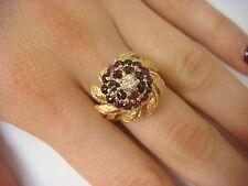VINTAGE GARNET AND DIAMOND FLOWER MOTIF COCKTAIL RING 14K YELLOW GOLD, 8.6 GRAMS