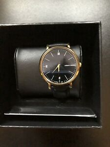 Larsson & Jennings Black&Gold Watch With Black Leather Strap.
