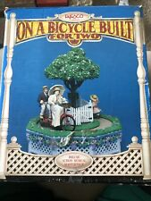 Enesco On A Bicycle Built For Two