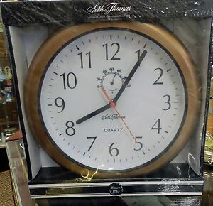WEATHER RESISTANT CLOCK WITH THERMOMETER MADE BY SETH THOMAS CLOCK CO WC02070