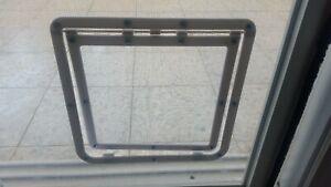 Cat door on mosquito net