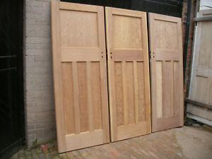 Reclaimed 1930s 1 over 3 panel stripped pine doors.