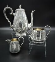 STUNNING ART NOUVEAU CHASED 3 PIECE TEASET SUGAR CREAMER TEAPOT SILVER PLATED