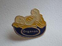 Pin's vintage Collector épinglette Publicitaire Organon Lot D110