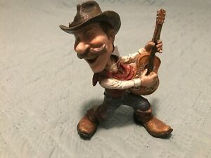 Western Cowboy Playing Guitar Figurine