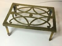 ANTIQUE SOLID BRASS FIRESIDE TRIVET OBLONG SHAPED WITH PIERCED TOP AND 4 LEGS