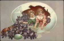 Easter - Children in Giant Egg w/ Flowers c1910 Postcard