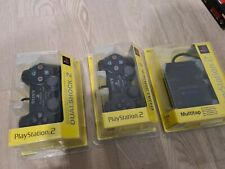 2 x SONY PS2 ORIGINAL DUAL SHOCK CONTROLLER GENUINE Sealed + sealed Multitap