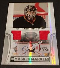 CURTIS McELHINNEY 2010-11 Certified Hockey DUAL JERSEY Masked Marvels Card # /99