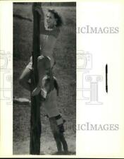 New listing 1989 Press Photo Son Helps Mom Climb Greased Pole At Texas Folklife Festival