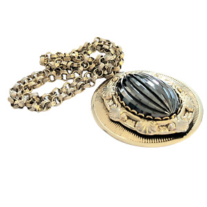Fancy Goldtone Metal Pendant with Oval Faceted Hematite Center