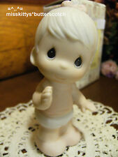 Precious Moments~E2852B~Baby Girl Figurine~Baby in Diaper a bow in Her Hair~ba