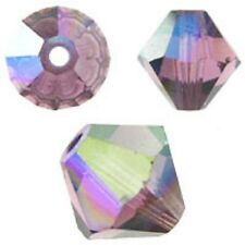 Swarovski Crystal Bicone Amethyst. AB 6mm. Approx. 48 PCS. 5328