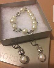 Swarovski pearl earrings worn once!