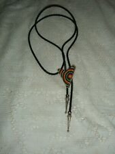YELLOW RED BLACK GREEN  BEADED V WINGED SHAPED  BOLO TIE USED