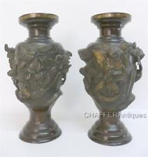Unusual Pair of Japanese Meiji Solid Bronze Vases in High Relief depicting Kami