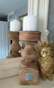 Large wooden pillar candle Holder and candle.