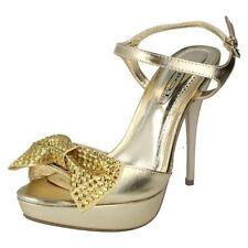 Sandali e scarpe stiletto oro per il mare da donna